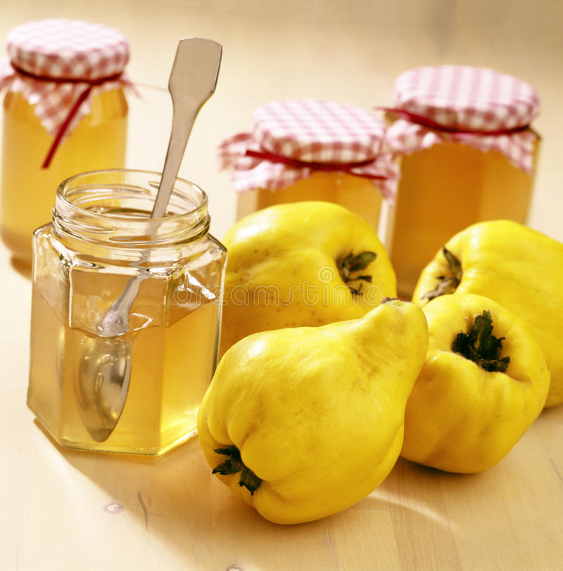 Quince jelly. Quinces and quince jelly in jars royalty free stock photography