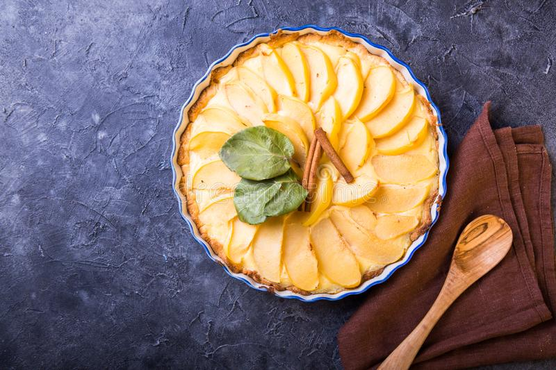Quince tart with custard open and shortcrust pastry and cinnamon stock photo