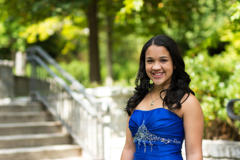 Quinceanera Dress. Teen girl wearing her formal Quinceanera dress royalty free stock image
