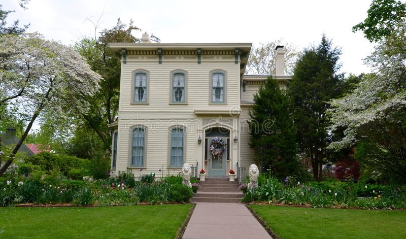 Quincy Italianate. This is a Spring picture of a house in Quincy, Illinois featuring trees and plants in full bloom. The house built in 1868 is an example of the royalty free stock images