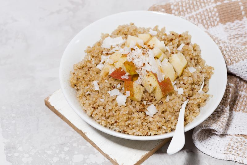 quinoa with apple and coconut for healthy breakfast, top view stock photography
