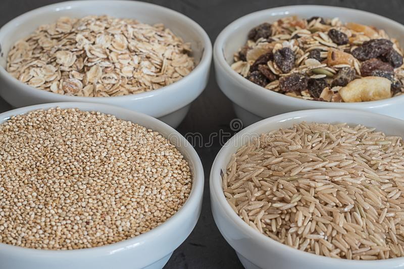 Quinoa, brown rice and oats. Healthy whole grain cereals. Vegan food concept. Quinoa, brown rice and oats. Healthy whole grain cereals. Concept Vegan food and royalty free stock photos