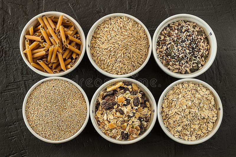 Quinoa, brown rice and oats. Healthy whole grain cereals. Vegan food concept. Quinoa, brown rice and oats. Healthy whole grain cereals. Concept Vegan food and stock photos