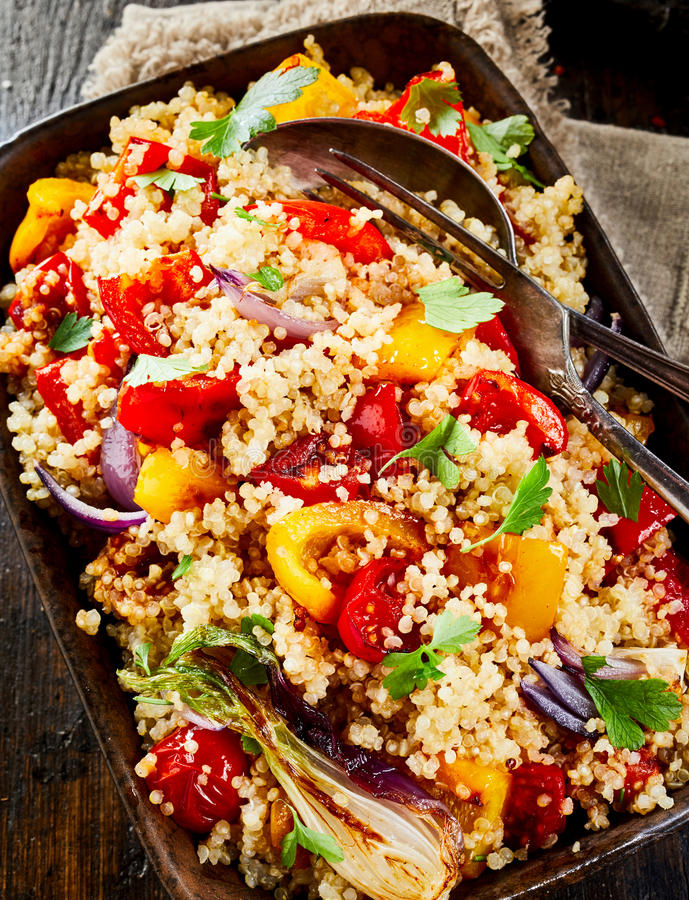 Quinoa served with vegetables on plate royalty free stock image