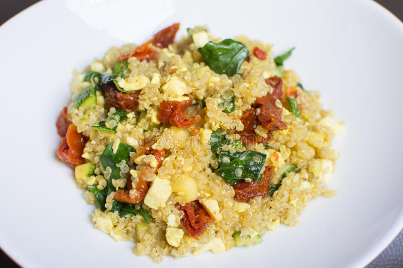 Quinoa with tofu and spinach royalty free stock photo