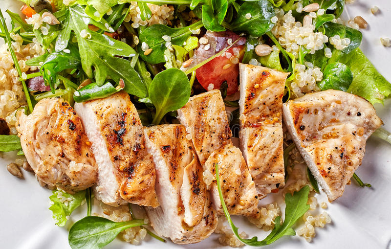 Quinoa and vegetable salad with grilled chicken royalty free stock image