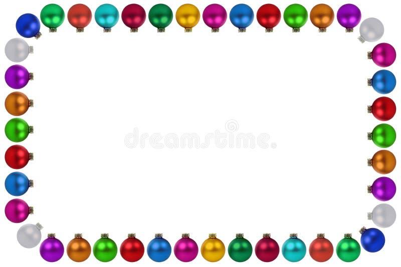 Quinquilharias das bolas do Natal muitas copyspace colorido do quadro da decoração imagens de stock
