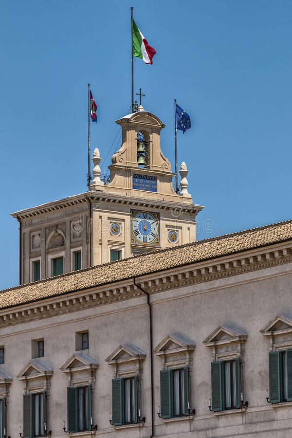 Quirinale Palace. Bell tower with flags of the Palazzo del Quirinale royalty free stock photography