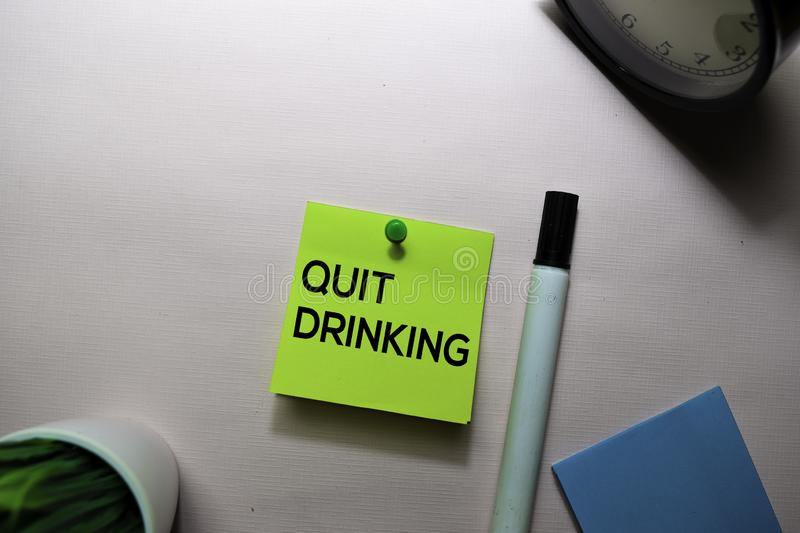 Quit Drinking text on sticky notes isolated on office desk stock image