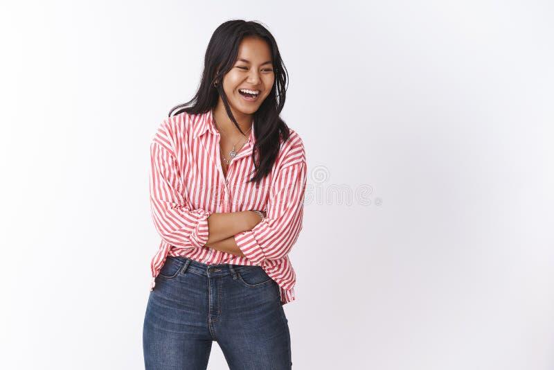 Quit joking. Portrait of happy and carefree joyful cute asian girl having fun laughing from funny friend having great. Quit joking. Happy and carefree joyful stock photography