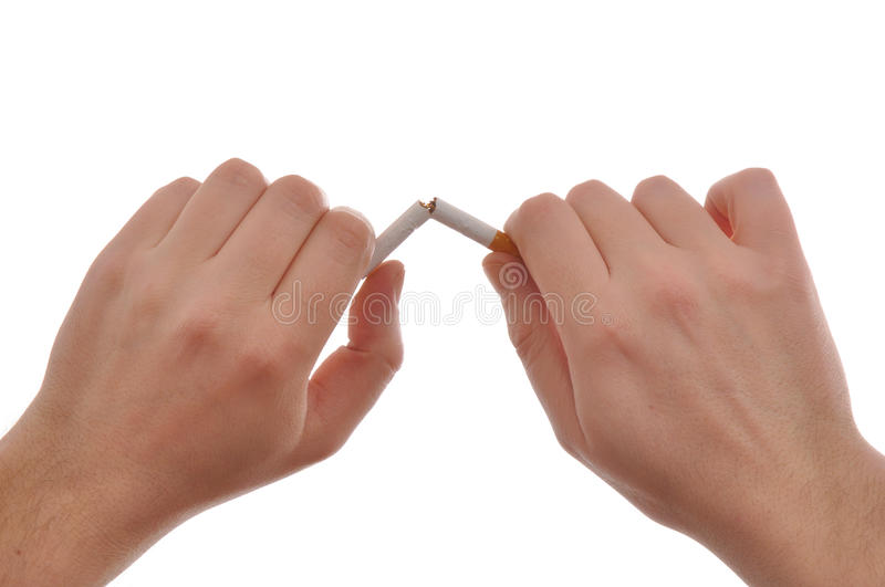 Quit smoking. Hands are breaking a cigarette royalty free stock images