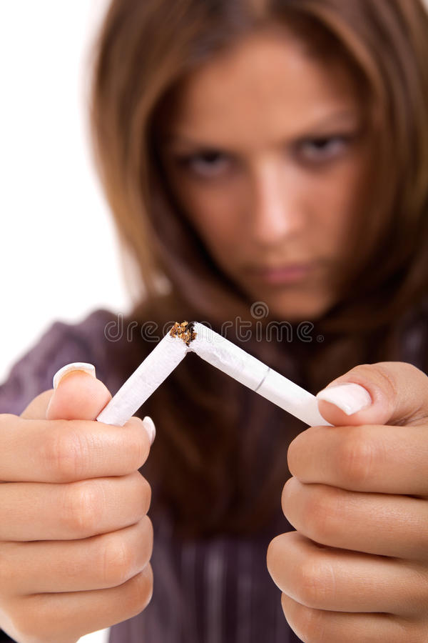 Quit smoking. Young attractive woman quitting smoking isolated royalty free stock images