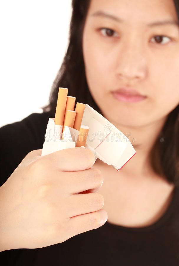 Quit smoking. Woman with a broken cigarettes on light background royalty free stock photo