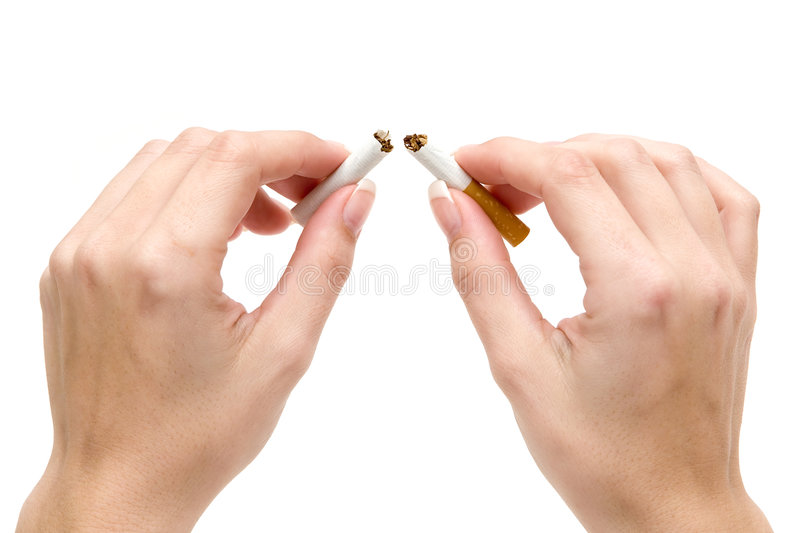 Quit Smoking. Woman breaking a cigarette. Isolated on a white background stock photography