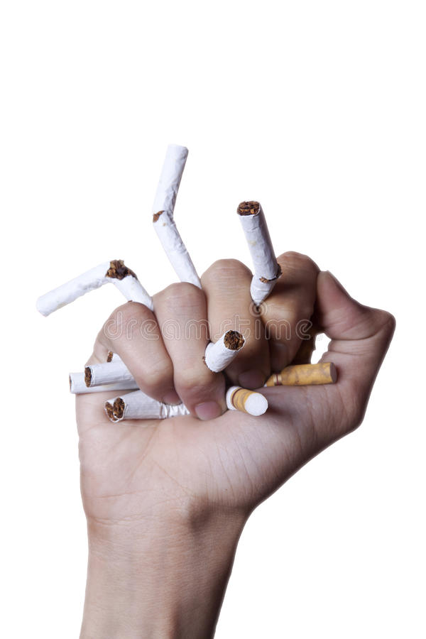 Quit smoking concept crushing cigarettes royalty free stock photo