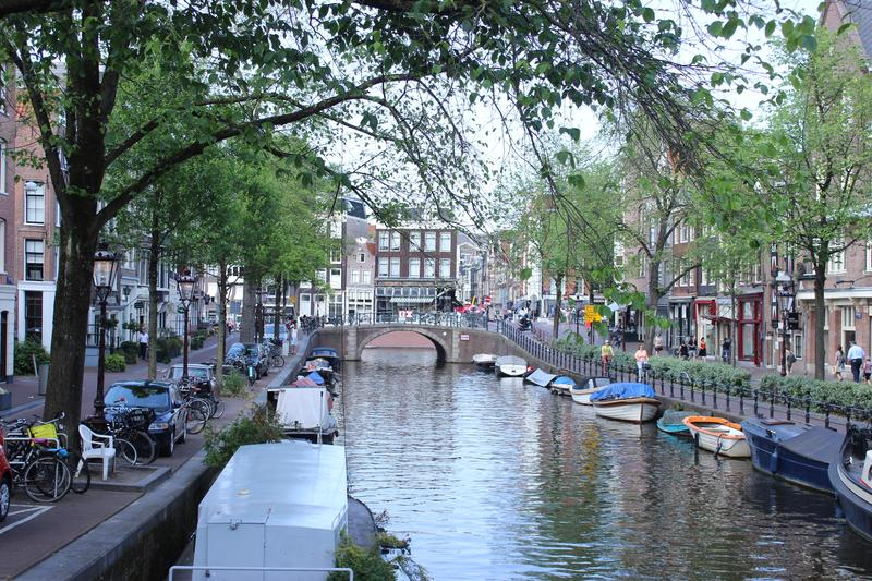Quite canal from Amsterdam with boats stock photography
