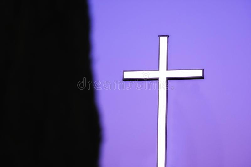 Glowing cross in night sky. Quite unique photo of a glowing cross in night sky. Large construction with soft white light; dark empty sky; darkness and light stock photography