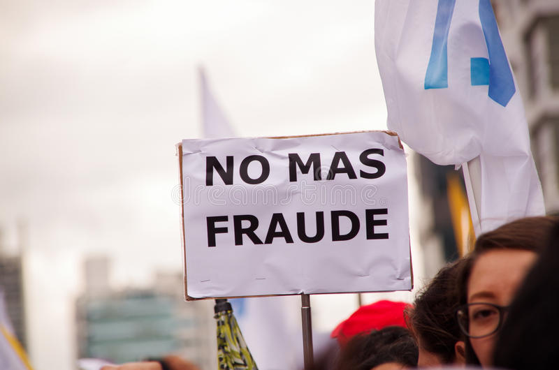 Quito, Ecuador - April 7, 2016: Crowd of unidentified people with banners rejecting the fraud and supporting the stock photography