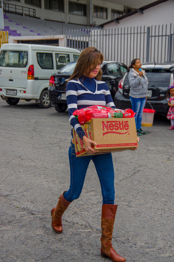 Quito, Ecuador - April,17, 2016: Unidentified citizens of Quito providing disaster relief food, clothes, medicine and stock photos