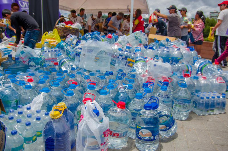 Quito, Ecuador - April,17, 2016: Unidentified citizens of Quito providing disaster relief water for earthquake survivors in the co stock photography