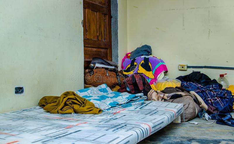 QUITO, ECUADOR, AUGUST 21, 2018: Pile of colorful clothes, bags and accessories in the ground of a room inside of a stock photos