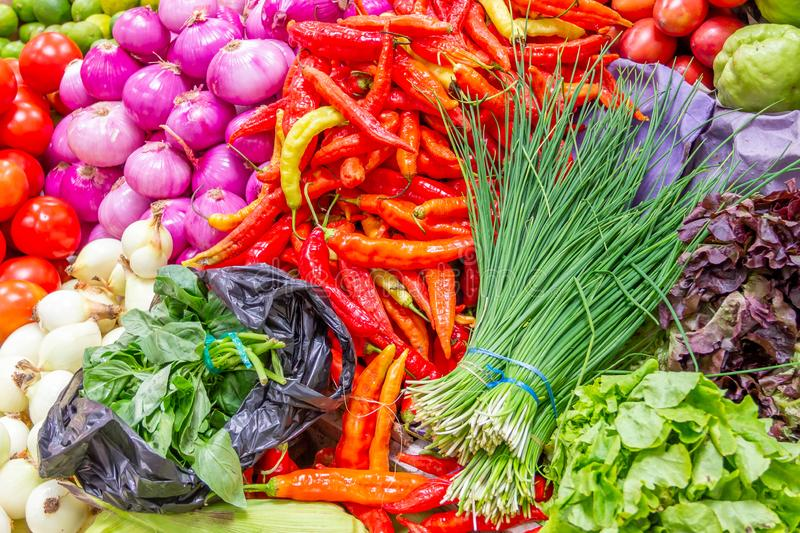 Quito, Ecuador - Chili Peppers, Chives, Onions and Other Fresh Vegetables at a Farmers Market stock photography