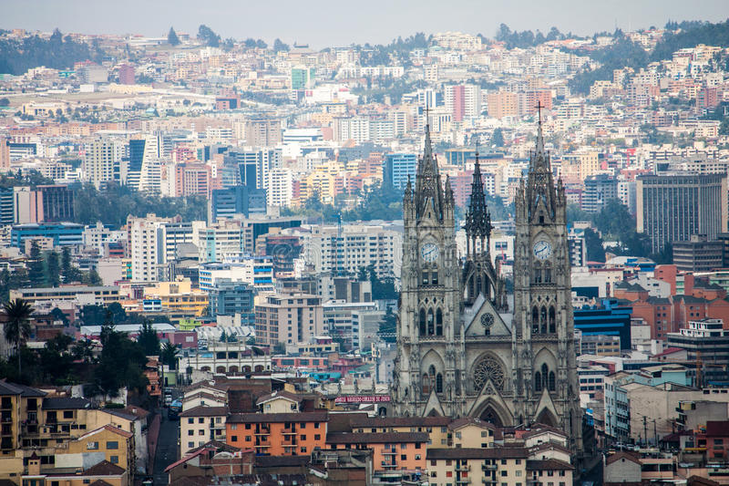 Quito Ecuador city view. A city view of the capital city of Quito Ecuador, looking down on the Basilica of the National Vow. Basílica del Voto Nacional stock photography