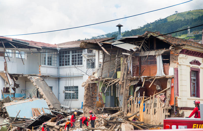 Quito, Ecuador - December 09, 2016: An unidentified group of firemans, cleaning the damage area and destruction, debris. After fire Inferno in buildings stock images