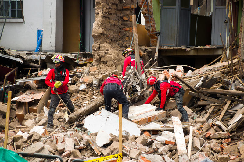 Quito, Ecuador - December 09, 2016: An unidentified group of firemans, Damage and destruction in building After Fire. Inferno royalty free stock photo