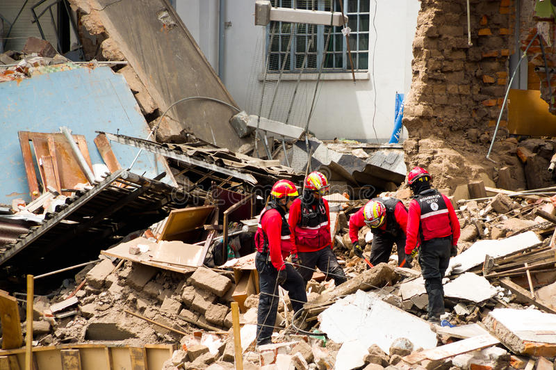 Quito, Ecuador - December 09, 2016: An unidentified group of firemans, Damage and destruction in building After Fire. Inferno stock image