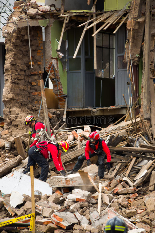 Quito, Ecuador - December 09, 2016: An unidentified group of firemans, Damage and destruction in building After Fire. Inferno stock photography