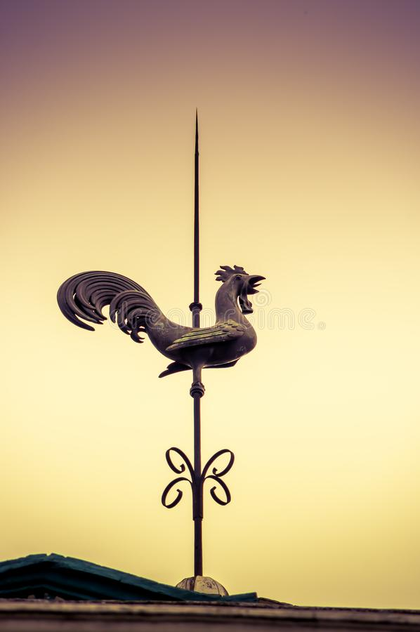 QUITO, ECUADOR NOVEMBER, 28, 2017: Outdoor view of a metallic old structure of a rooster in the top of a building royalty free stock images