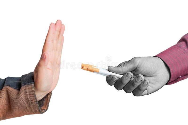 Quitting smoking. Man quitting smoking isolated on white background stock photos