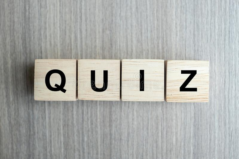 QUIZ text wood cube   on wooden table background. QUIZ text wood cube on wooden table background royalty free stock images