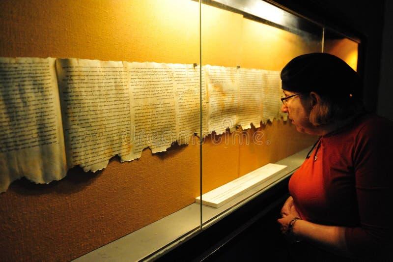 Qumran Caves - Israel. QUMRAN, ISR - DEC 14:Woman looks at the Dead Sea Scrolls on display at the caves of Qumran on December 14 2008.The Dead Sea Scrolls were