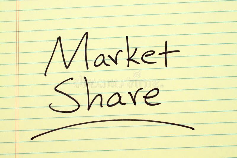 Quota di mercato su un blocco note giallo fotografie stock libere da diritti