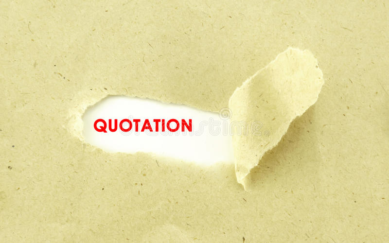 QUOTATION. Text QUOTATION appearing behind torn light brown envelope royalty free stock photo