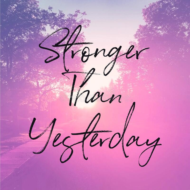 Quote - Stronger than yesterday with pink road royalty free stock image