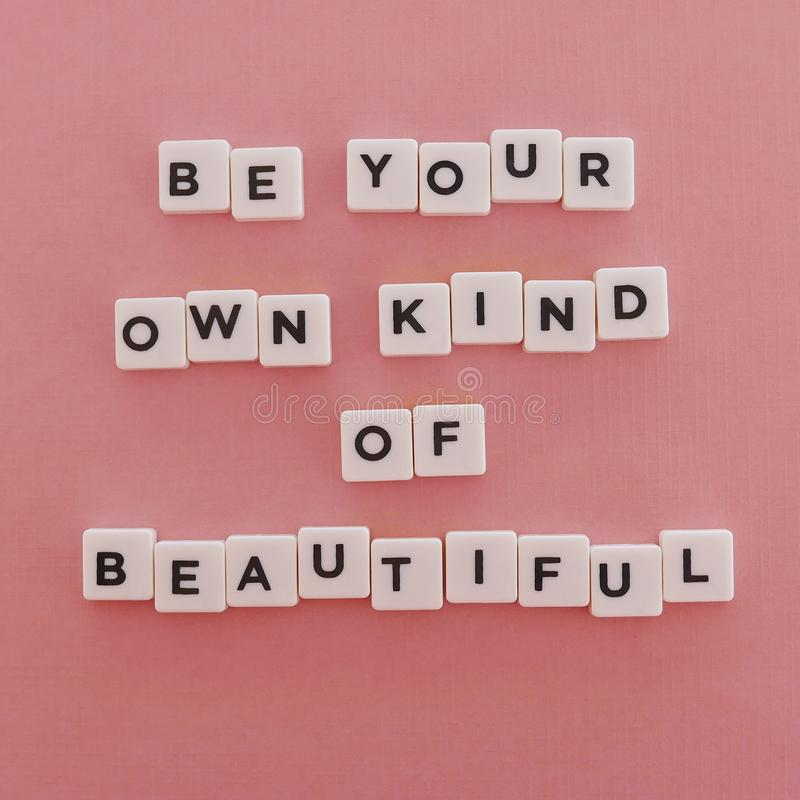 "Quotes ""Be Your Own Kind Of Beautiful"" on pink background stock photography"