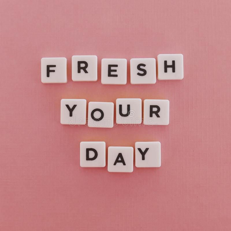 "Quotes ""Fresh Your Day"" on pink background stock photos"