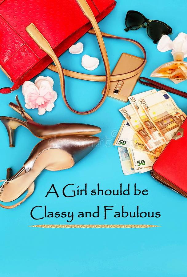 Business   Woman Accessories Red Wallet with money euro Red handbag  perfume black Sunglass And Gold  Shoes on High Heels on Blue. Quotes Of Girl and  Women Red stock photography
