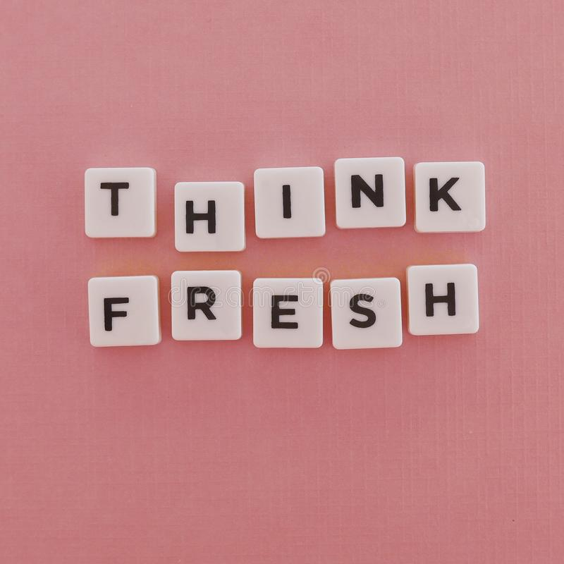 "Quotes ""Think Fresh"" on pink background royalty free stock photo"
