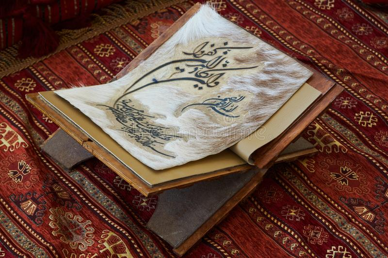 Quran book page in the mosque - open for prayers, close-up. royalty free stock photo