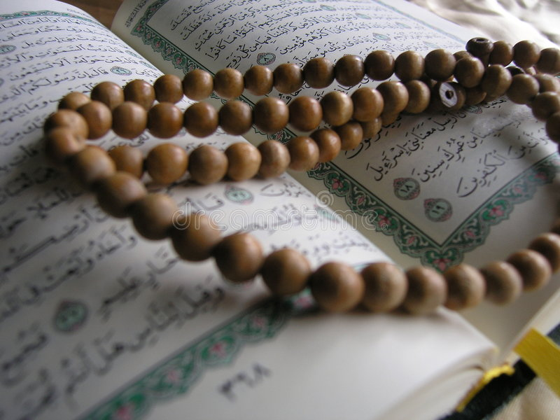Quran and Dhikr Beads. The Noble QUr 'an with Dhikr Beads resting upon it royalty free stock photo