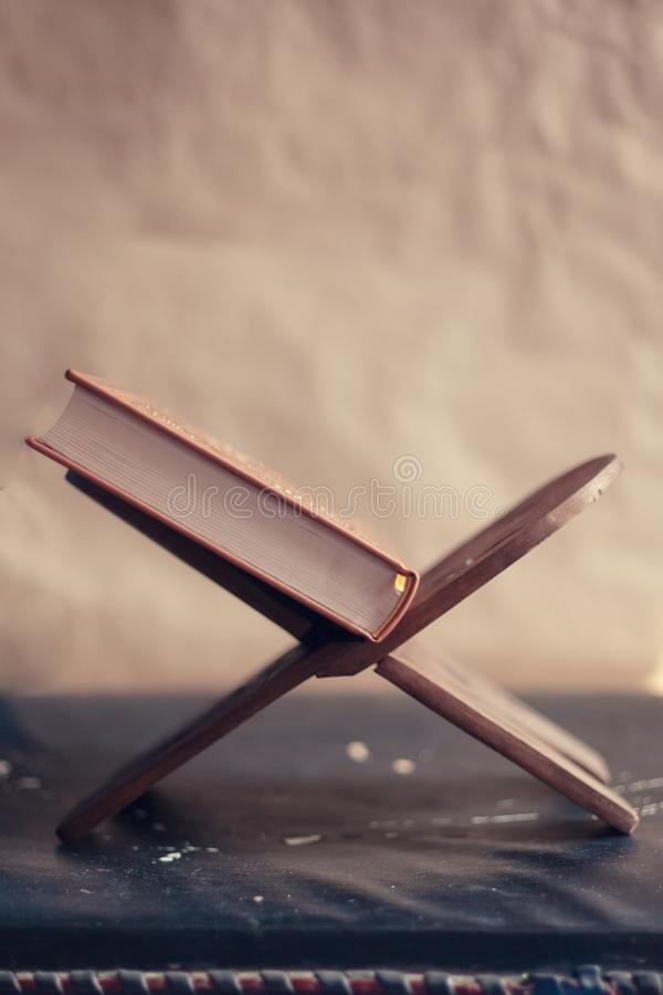 Quran - holy book on book stand royalty free stock photo