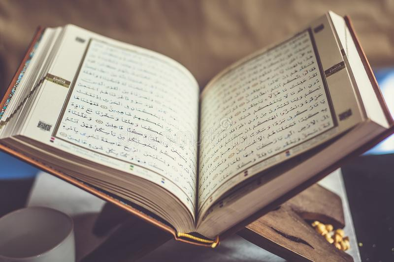 Quran - holy book on book stand. Open for prayers. Holy book of Islam stock photography