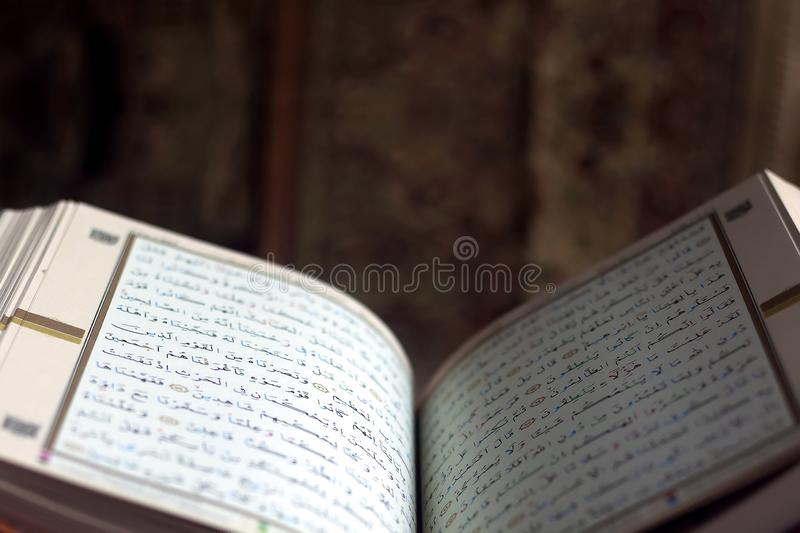 Quran - holy book on book stand. Open for prayers. Holy book of Islam stock photo