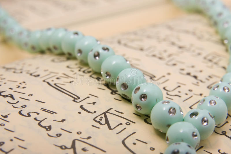 Quran and rosary royalty free stock image