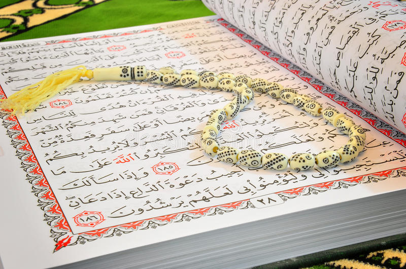 Quran And Rosary stock image