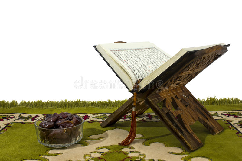 Quran on wood stand and dates royalty free stock image